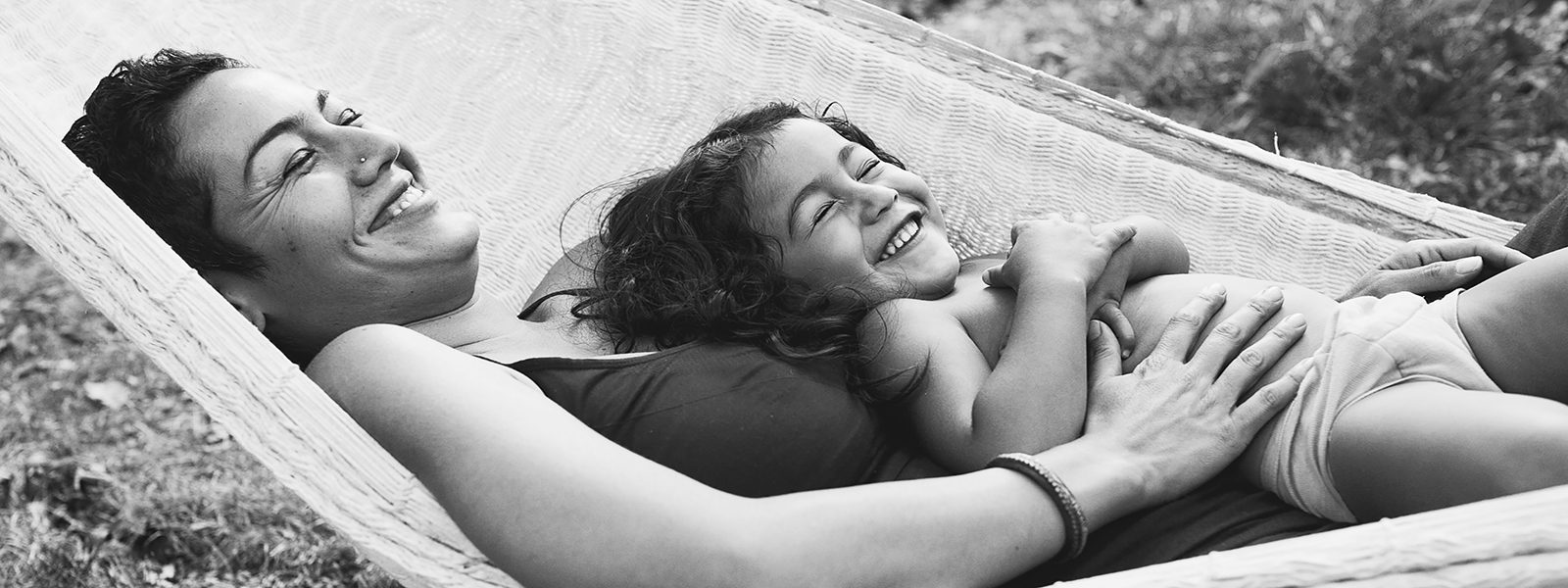 Amanda Reed Photography slideshow image of mother and daughter relaxing and laughing while in a hammock